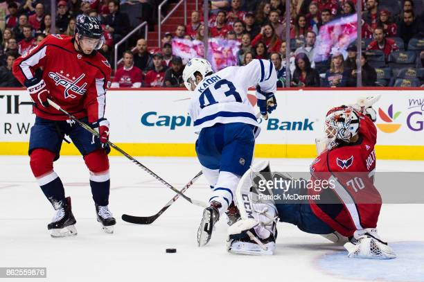 Nazem Kadri of the Toronto Maple Leafs and Evgeny Kuznetsov of the Washington Capitals battle for the puck in front of Braden Holtby in the second...