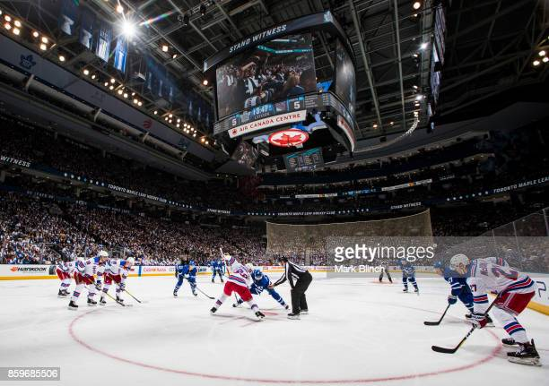 Nazem Kadri of the Toronto Maple Leafs and Mika Zibanejad of the New York Rangers face off during the second period October 7 2017 at the Air Canada...