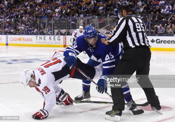 Nazem Kadri of the Toronto Maple Leafs and Nicklas Backstrom of the Washington Capitals get tangled up on a faceoff during the second period in Game...