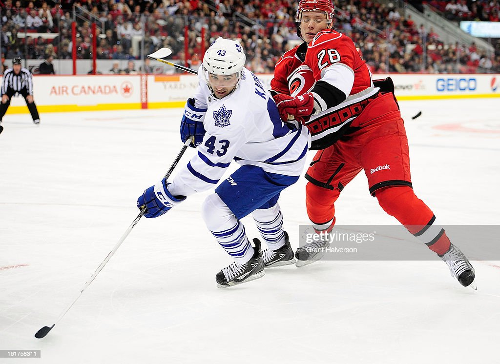 Nazem Kadri #43 of the Toronto Maple Leafs battles for position with Alexander Semin #28 of the Carolina Hurricanes during play at PNC Arena on February 14, 2013 in Raleigh, North Carolina.