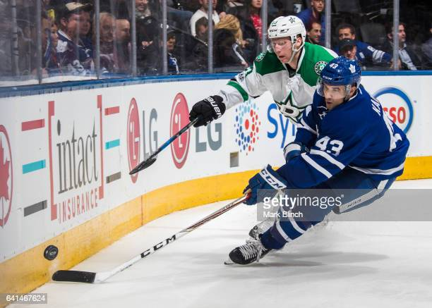Nazem Kadri of the Toronto Maple Leafs battles for the puck with Esa Lindell of the Dallas Stars during the third period at the Air Canada Centre on...