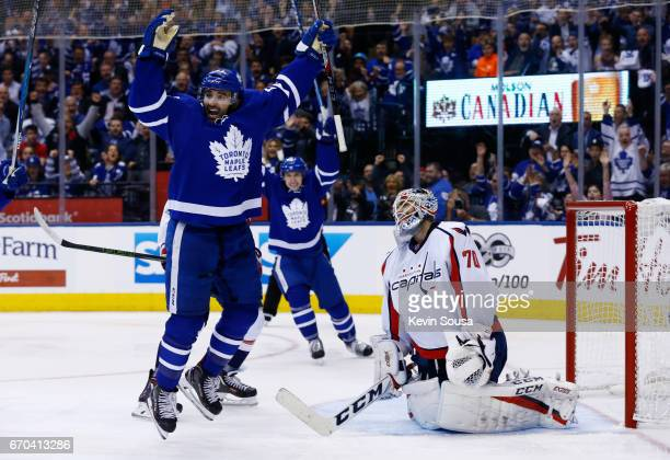 Nazem Kadri of the Toronto Maple Leafs celebrates a goal by teammate James van Riemsdyk as Braden Holtby of the Washington Capitals reacts during the...