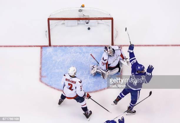Nazem Kadri of the Toronto Maple Leafs celebrates a goal by teammate James van Riemsdyk against Matt Niskanen and Braden Holtby of the Washington...