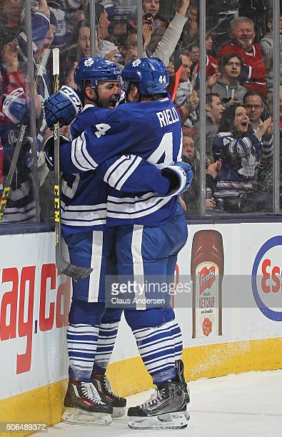 Nazem Kadri of the Toronto Maple Leafs celebrates his goal with teammate Morgan Reilly against the Montreal Canadiens during an NHL game at the Air...