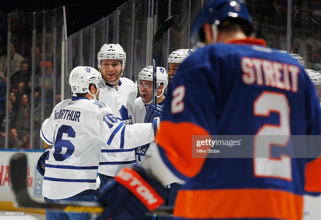 Nazem Kadri #43 of the Toronto Maple Leafs celebrates his second goal of the game with teammates Clarke MacArthur #16 and Cody Franson #4 as Mark Streit #2 of the New York Islanders skates by at Nassau Veterans Memorial Coliseum on February 28, 2013 in Uniondale, New York.