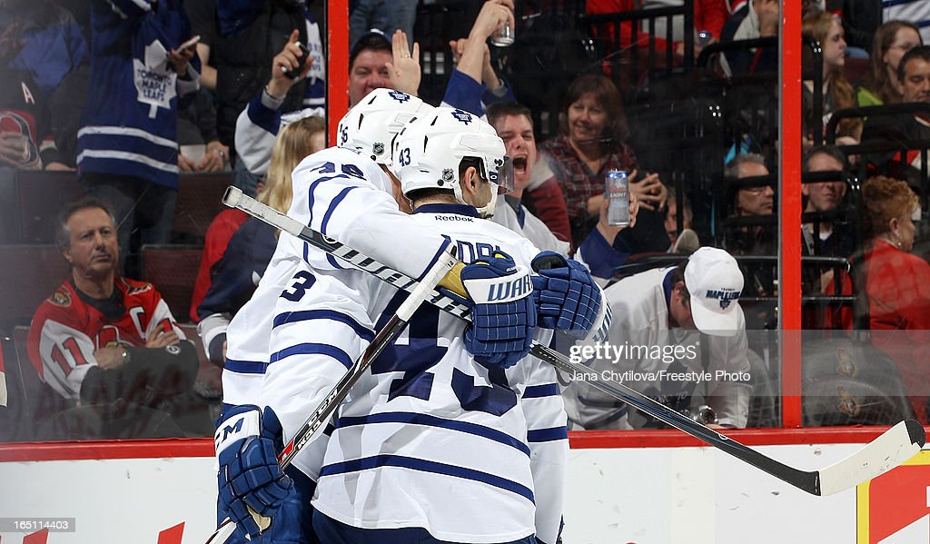 <a gi-track='captionPersonalityLinkClicked' href=/galleries/search?phrase=Nazem+Kadri&family=editorial&specificpeople=4043234 ng-click='$event.stopPropagation()'>Nazem Kadri</a> #43 of the Toronto Maple Leafs celebrates his second goal of the game with teammate <a gi-track='captionPersonalityLinkClicked' href=/galleries/search?phrase=Carl+Gunnarsson&family=editorial&specificpeople=5557315 ng-click='$event.stopPropagation()'>Carl Gunnarsson</a> #36 during an NHL game against the Ottawa Senators, at Scotiabank Place, on March 30, 2013 in Ottawa, Ontario, Canada.