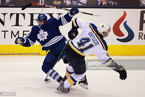 TORONTO ON MARCH 7 Nazem Kadri of the Toronto Maple Leafs checked by Robert Bortuzzo of the St Louis Blues during second period NHL action at the Air...