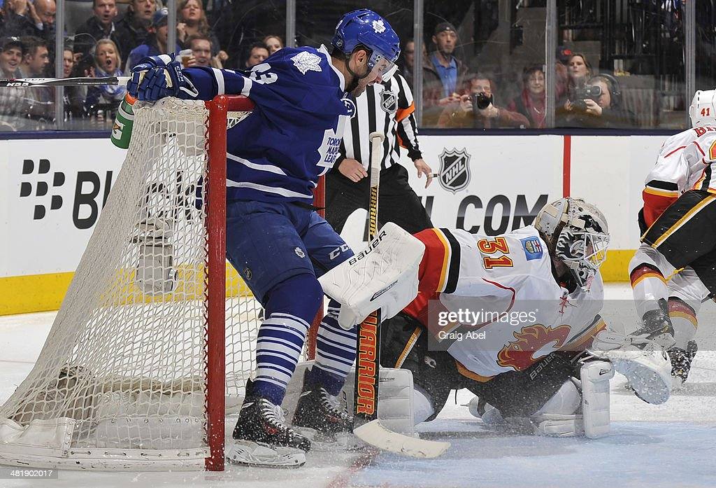 Nazem Kadri #43 of the Toronto Maple Leafs collides with goalie Karri Ramo #31 of the Calgary Flames during NHL game action April 1, 2014 at the Air Canada Centre in Toronto, Ontario, Canada.