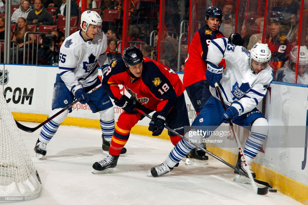 Nazem Kadri #43 of the Toronto Maple Leafs digs the puck out from the boards against Shawn Matthias #18 of the Florida Panthers at the BB&T Center on February 18, 2013 in Sunrise, Florida.