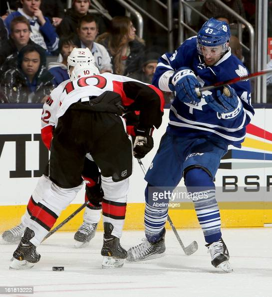 Nazem Kadri of the Toronto Maple Leafs gets around Mike Lundin of the Ottawa Senators during NHL action at the Air Canada Centre February 16 2013 in...