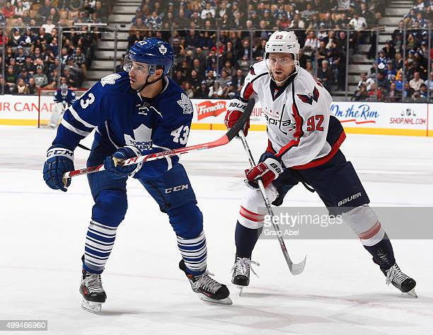 Nazem Kadri of the Toronto Maple Leafs gets by Evgeny Kuznetsov of the Washington Capitals during game action on November 28 2015 at Air Canada...