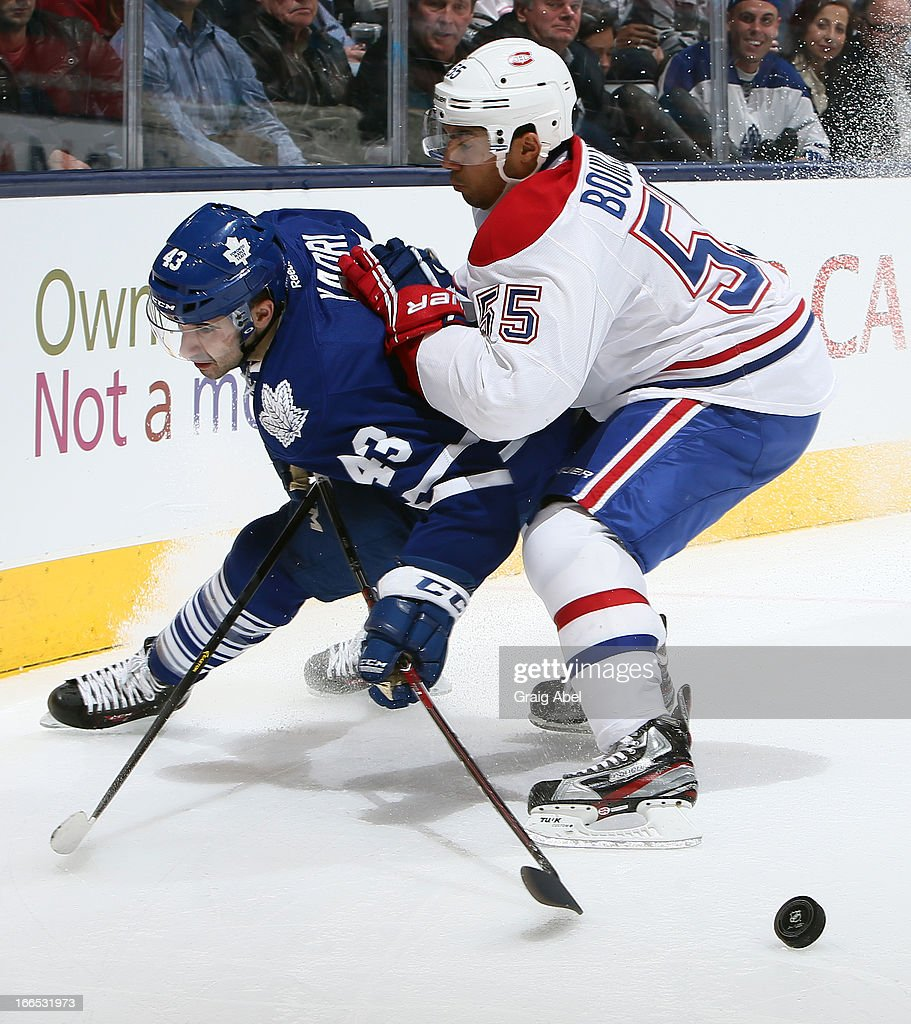 <a gi-track='captionPersonalityLinkClicked' href=/galleries/search?phrase=Nazem+Kadri&family=editorial&specificpeople=4043234 ng-click='$event.stopPropagation()'>Nazem Kadri</a> #43 of the Toronto Maple Leafs gets hit by <a gi-track='captionPersonalityLinkClicked' href=/galleries/search?phrase=Francis+Bouillon&family=editorial&specificpeople=215165 ng-click='$event.stopPropagation()'>Francis Bouillon</a> #55 of the Montreal Canadiens during game action April 13, 2013 at the Air Canada Centre in Toronto, Ontario, Canada.