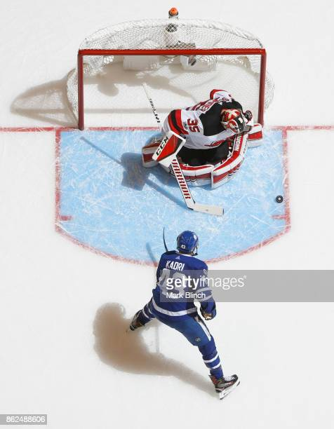 Nazem Kadri of the Toronto Maple Leafs goes to the net against Cory Schneider of the New Jersey Devils during the first period at the Air Canada...