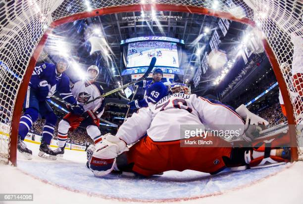 Nazem Kadri of the Toronto Maple Leafs goes to the net against Joonas Korpisalo of the Columbus Blue Jackets during the first period at the Air...