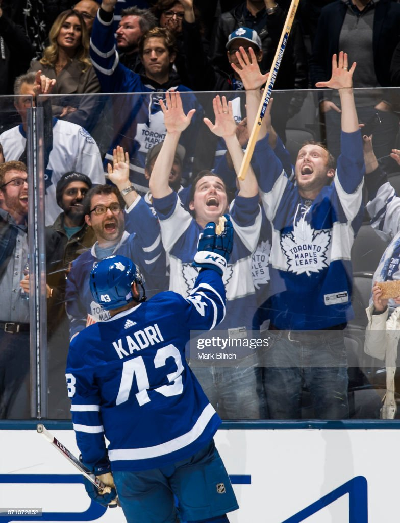 Nazem Kadri #43 of the Toronto Maple Leafs hands a stick to fans after being named one of the stars of the game against the Vegas Golden Knights at the Air Canada Centre on November 6, 2017 in Toronto, Ontario, Canada.