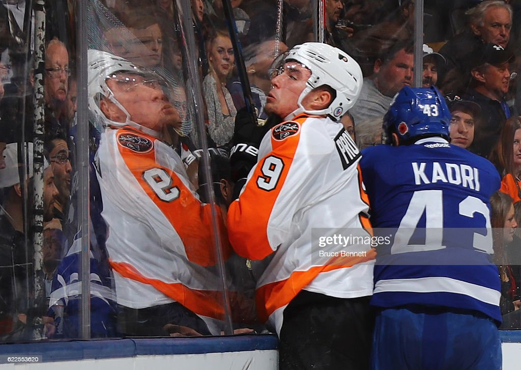 Nazem Kadri #43 of the Toronto Maple Leafs hits Ivan Provorov #9 of the Philadelphia Flyers into the glass during the second period at the Air Canada Centre on November 11, 2016 in Toronto, Canada.