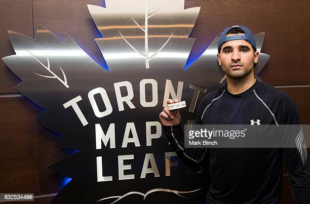Nazem Kadri of the Toronto Maple Leafs holds the puck from his 100th NHL goal scored against the Calgary Flames at the Air Canada Centre on January...