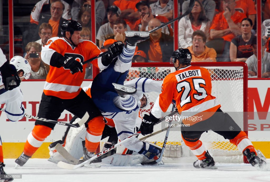 Nazem Kadri of the Toronto Maple Leafs is flipped into the net by Nicklas Grossmann of the Philadelphia Flyers at the Wells Fargo Center on October 2...