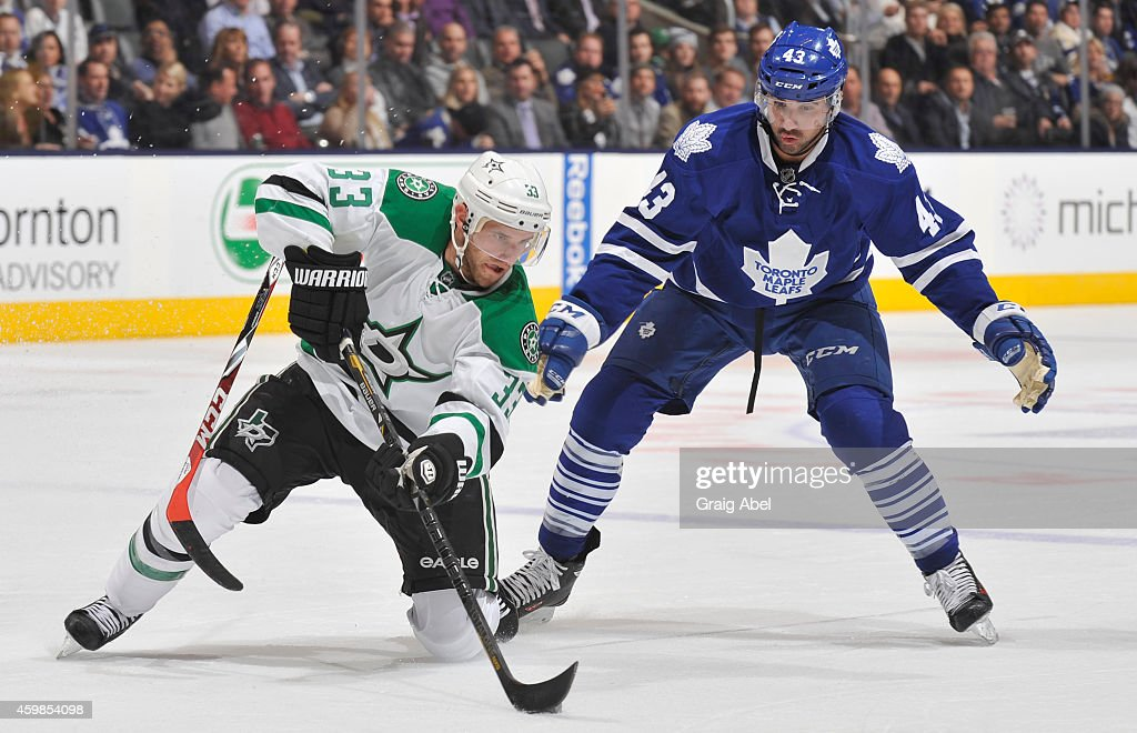 Nazem Kadri of the Toronto Maple Leafs loses his stick as Alex Goligoski of the Dallas Stars looks to pass the puck during NHL game action December 2...