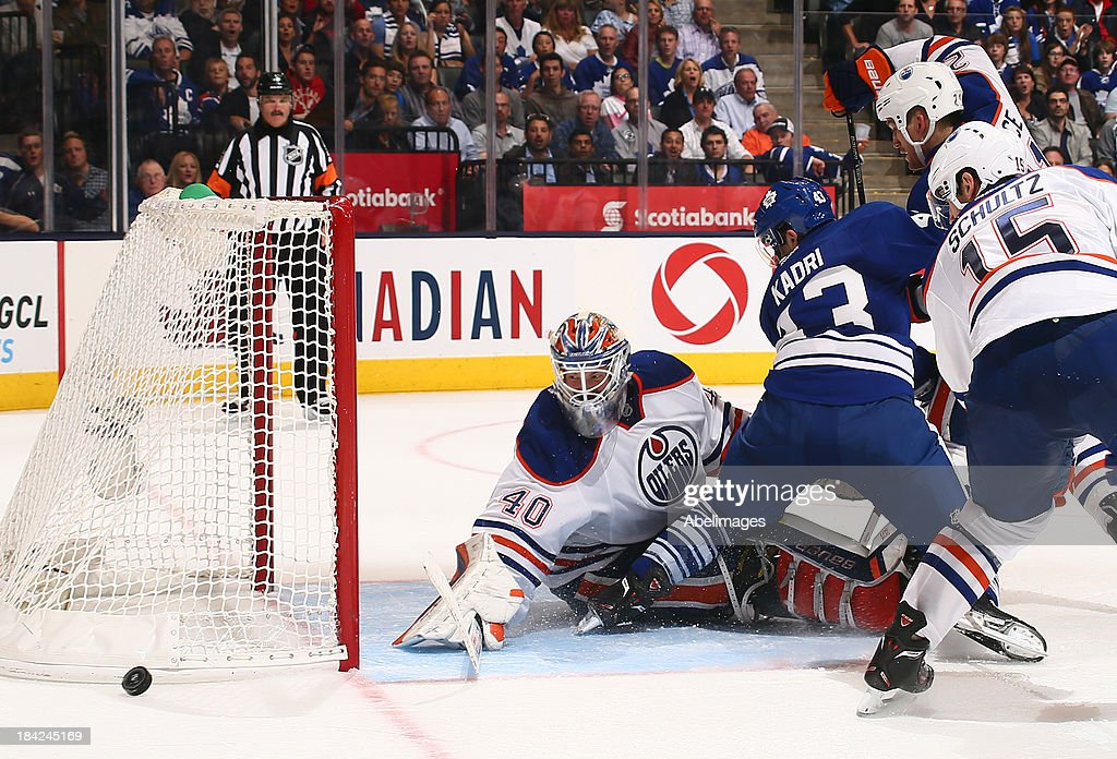 <a gi-track='captionPersonalityLinkClicked' href=/galleries/search?phrase=Nazem+Kadri&family=editorial&specificpeople=4043234 ng-click='$event.stopPropagation()'>Nazem Kadri</a> #43 of the Toronto Maple Leafs misses on <a gi-track='captionPersonalityLinkClicked' href=/galleries/search?phrase=Devan+Dubnyk&family=editorial&specificpeople=2089794 ng-click='$event.stopPropagation()'>Devan Dubnyk</a> #40 of the Edmonton Oilers during NHL action at the Air Canada Centre October 12, 2013 in Toronto, Ontario, Canada.