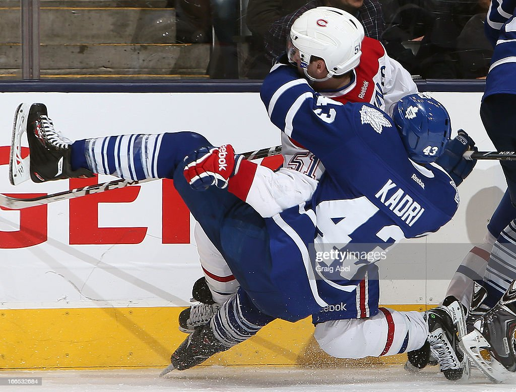<a gi-track='captionPersonalityLinkClicked' href=/galleries/search?phrase=Nazem+Kadri&family=editorial&specificpeople=4043234 ng-click='$event.stopPropagation()'>Nazem Kadri</a> #43 of the Toronto Maple Leafs runs into <a gi-track='captionPersonalityLinkClicked' href=/galleries/search?phrase=David+Desharnais&family=editorial&specificpeople=4084305 ng-click='$event.stopPropagation()'>David Desharnais</a> #51 of the Montreal Canadiens during game action April 13, 2013 at the Air Canada Centre in Toronto, Ontario, Canada.