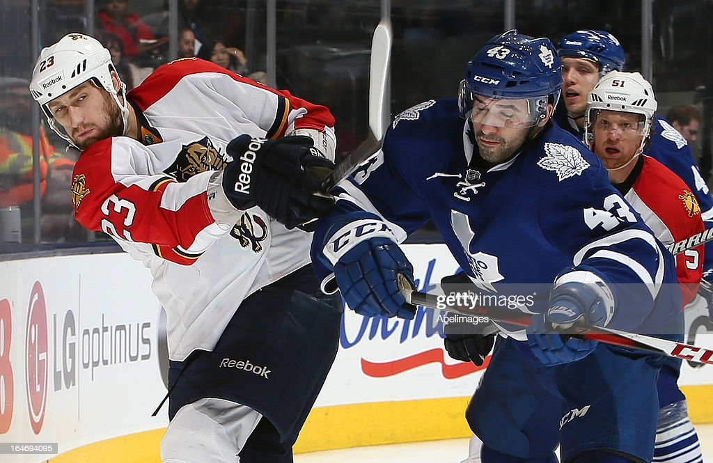 Nazem Kadri #43 of the Toronto Maple Leafs runs into Tyson Strachan #23 of the Florida Panthers during NHL action at the Air Canada Centre March 26, 2013 in Toronto, Ontario, Canada.