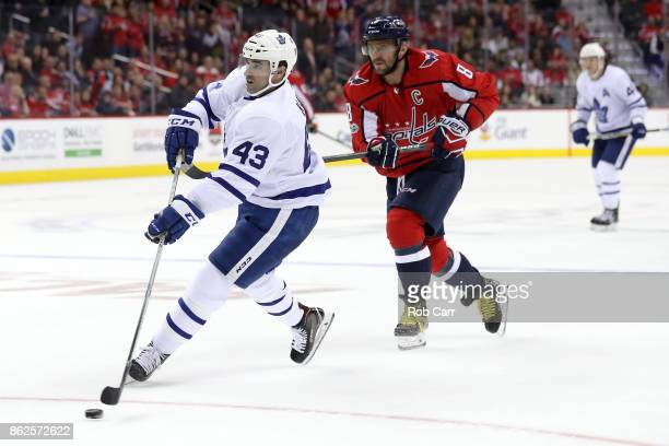 Nazem Kadri of the Toronto Maple Leafs scores an empty net goal in front of Alex Ovechkin of the Washington Capitals in the third period at Capital...