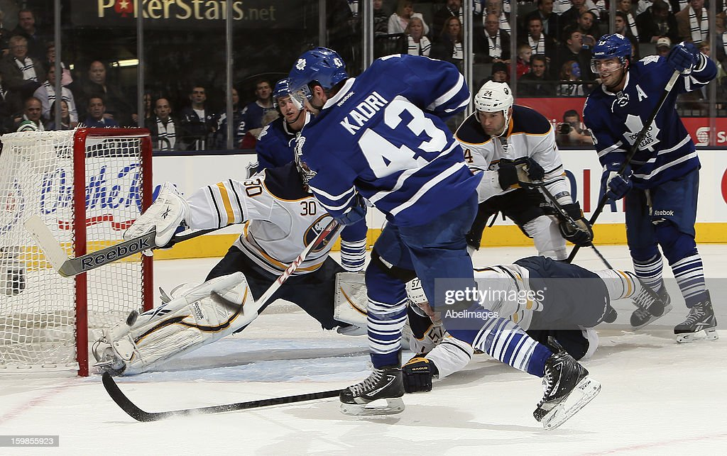 <a gi-track='captionPersonalityLinkClicked' href=/galleries/search?phrase=Nazem+Kadri&family=editorial&specificpeople=4043234 ng-click='$event.stopPropagation()'>Nazem Kadri</a> #43 of the Toronto Maple Leafs scores on Ryan Miller #30 of the Buffalo Sabres during NHL action at the Air Canada Centre January 21, 2013 in Toronto, Ontario, Canada.