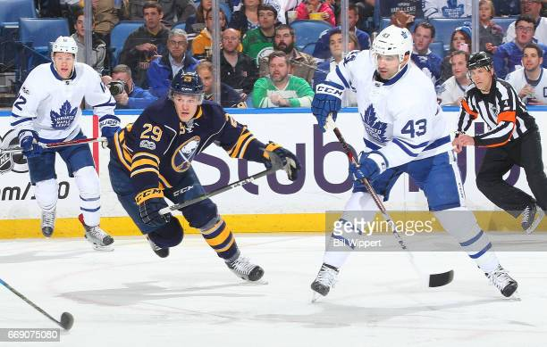 Nazem Kadri of the Toronto Maple Leafs shoots the puck while defended by Jake McCabe of the Buffalo Sabres during an NHL game at the KeyBank Center...