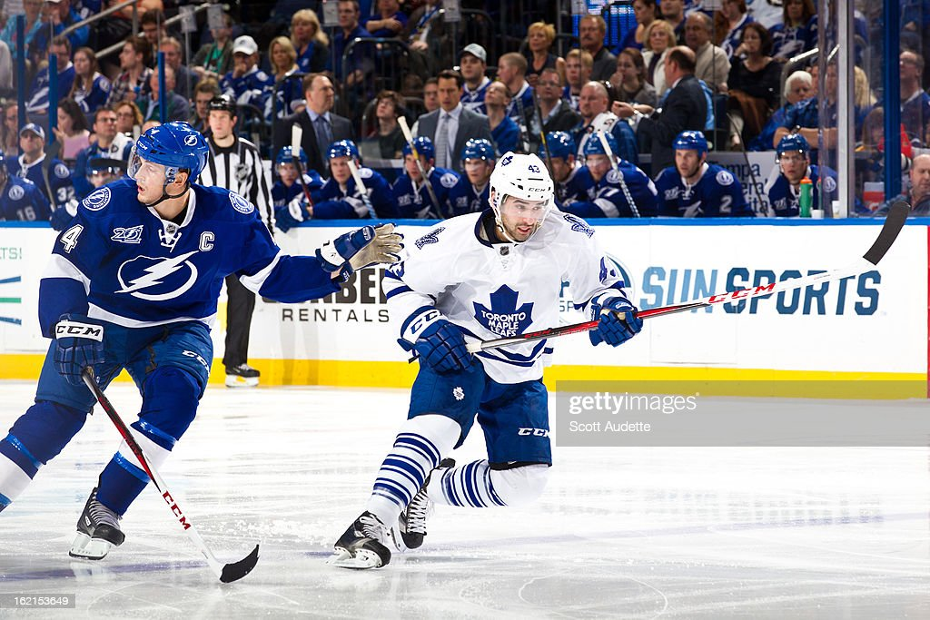 <a gi-track='captionPersonalityLinkClicked' href=/galleries/search?phrase=Nazem+Kadri&family=editorial&specificpeople=4043234 ng-click='$event.stopPropagation()'>Nazem Kadri</a> #43 of the Toronto Maple Leafs skates ahead of <a gi-track='captionPersonalityLinkClicked' href=/galleries/search?phrase=Vincent+Lecavalier&family=editorial&specificpeople=201915 ng-click='$event.stopPropagation()'>Vincent Lecavalier</a> #4 of the Tampa Bay Lightning during the third period of the game at the Tampa Bay Times Forum on February 19, 2013 in Tampa, Florida.