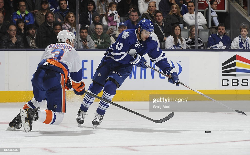 <a gi-track='captionPersonalityLinkClicked' href=/galleries/search?phrase=Nazem+Kadri&family=editorial&specificpeople=4043234 ng-click='$event.stopPropagation()'>Nazem Kadri</a> #43 of the Toronto Maple Leafs skates the puck around <a gi-track='captionPersonalityLinkClicked' href=/galleries/search?phrase=Travis+Hamonic&family=editorial&specificpeople=4605791 ng-click='$event.stopPropagation()'>Travis Hamonic</a> #3 of the New York Islanders during NHL game action January 24, 2013 at the Air Canada Centre in Toronto, Ontario, Canada.