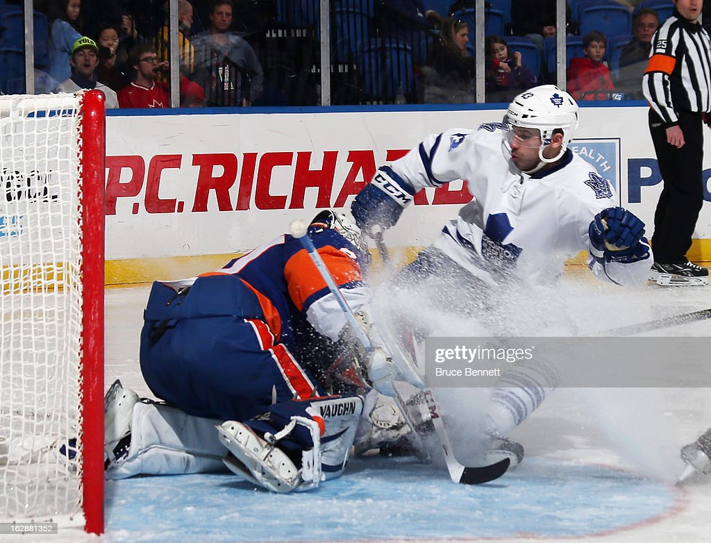 <a gi-track='captionPersonalityLinkClicked' href=/galleries/search?phrase=Nazem+Kadri&family=editorial&specificpeople=4043234 ng-click='$event.stopPropagation()'>Nazem Kadri</a> #43 of the Toronto Maple Leafs stops in front of <a gi-track='captionPersonalityLinkClicked' href=/galleries/search?phrase=Evgeni+Nabokov&family=editorial&specificpeople=171380 ng-click='$event.stopPropagation()'>Evgeni Nabokov</a> #20 of the New York Islanders at the Nassau Veterans Memorial Coliseum on February 28, 2013 in Uniondale, New York. The Leafs defeated the Islanders 5-4 in overtime.