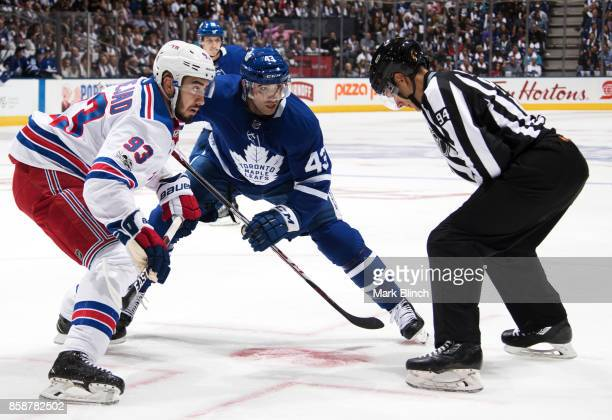 Nazem Kadri of the Toronto Maple Leafs takes a face off against Mika Zibanejad of the New York Rangers during the first period October 7 2017 at the...