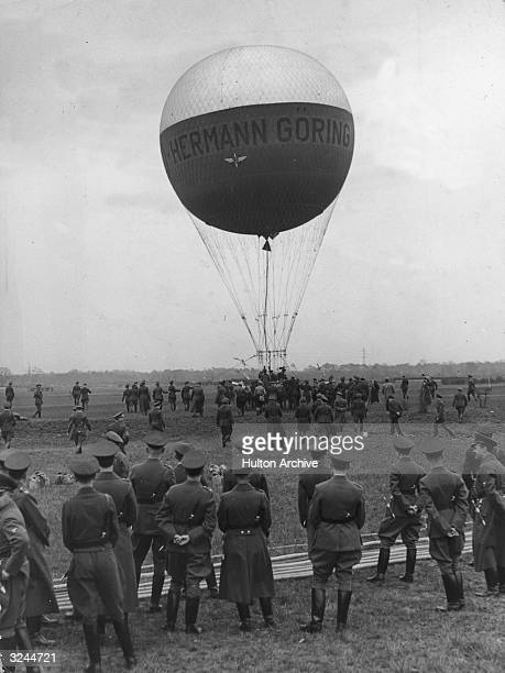 Nazi Air Force soldiers gather to witness a test flight of the Herman Goring balloon in preparation for World War II Germany The balloon was used to...