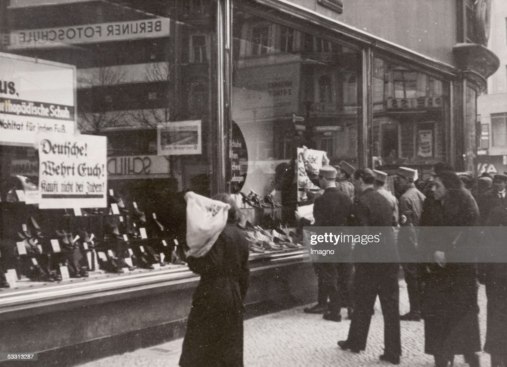 Nazi boycott against Jewish shops in Germany SA members sticking antiSemitic signboards on Jewish shops in Berlin Photography 1933 [Boykott der...