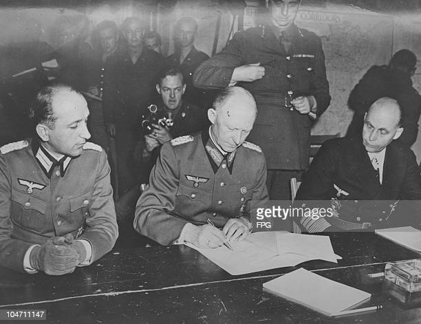 Nazi chief of staff General Gustaf Jodl signing the unconditional surrender of the Wehrmacht to end World War II in Rheims France circa 1945