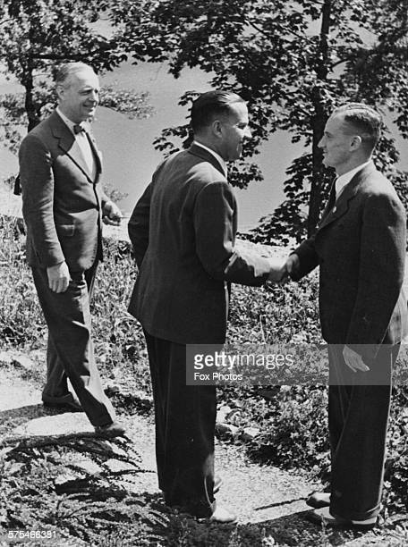 Nazi Foreign Minister Joachim Von Ribbentrop watching as Italian Foreign Minsiter Count Galeazzo Ciano shakes hands with Austrian Nazi politician...