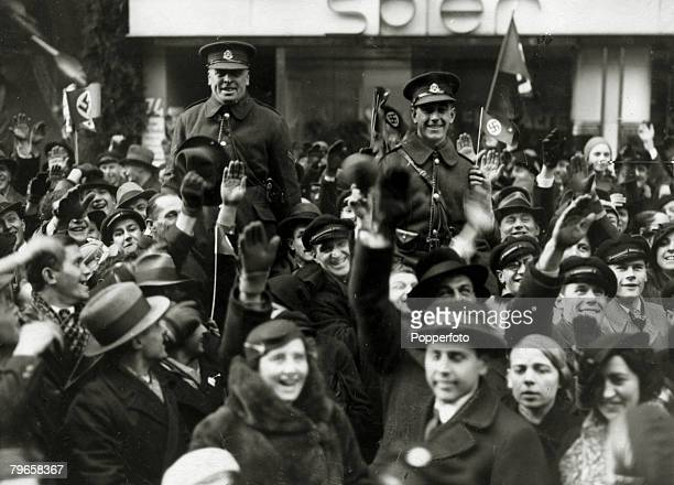 1935 The Saar Two members of the British force sent to Saarbrucken for the Plebiscite being feted by Germans after the result was announced