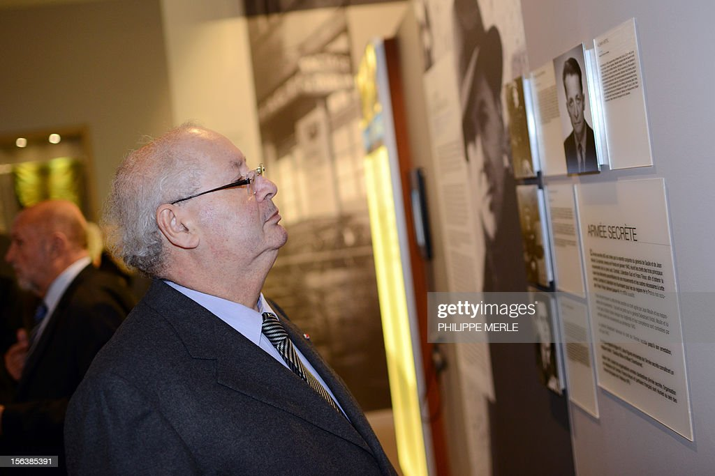 Nazi hunter, French lawyer and President of the 'Association des fils et filles des deportes juifs de France' (Sons and daughters of Jews deported from France), Serge Klarsfeld looks at a poster during an exhibition dedicated to French Resistance leader during World War II, Jean Moulin, on November 14, 2012 at the Centre of History of French Resistance and Deportation (CHRD) in Lyon, eastern France, two days ahead of its reopening after a one-year revamp.