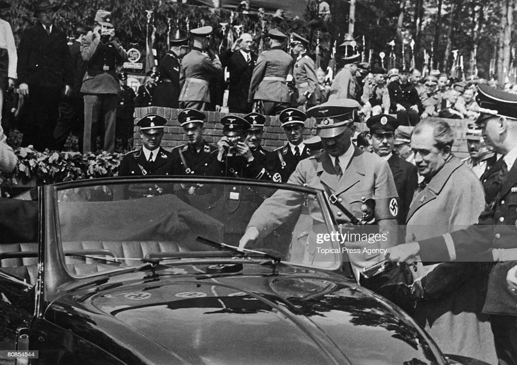 Nazi leader Adolf Hitler inspects the new Volkswagen 'people's car' at the Fallersleben car factory 27th May 1938 The factory is designed to...