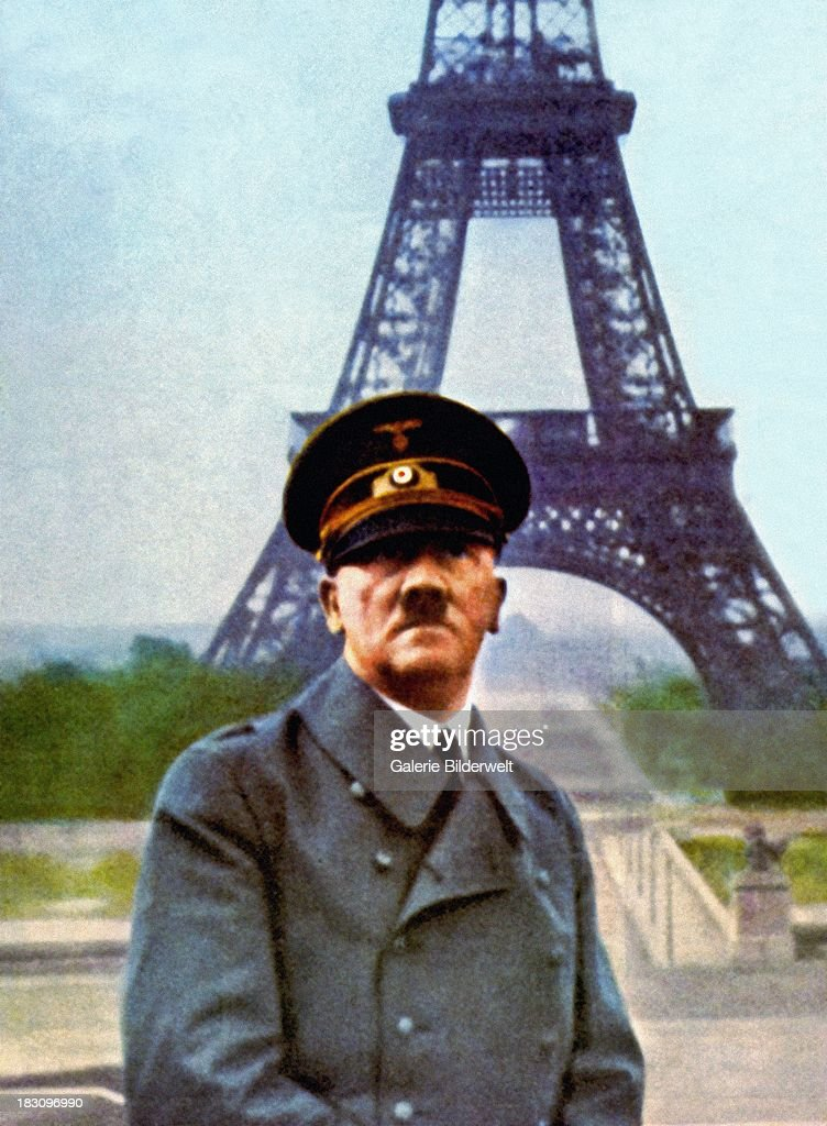 Nazi leader Adolf Hitler (1889 - 1945) posing in front of the Eiffel Tower during a visit to Paris the day after the French surrender and the signing of the Second Armistice at Compiegne, 23rd June 1940.