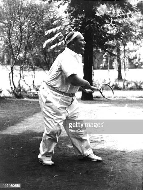 Nazi leader Hermann Goering plays tennis in the garden of his villa Carinhall Prussia June 4 1936