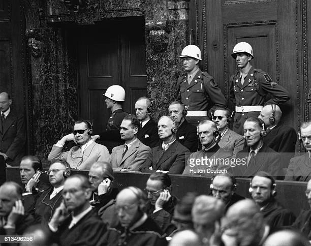 Nazi military leaders accused of wartime atrocities listen to proceedings in the dock at the Nuremberg Trials in 1946 Among them are the head of the...