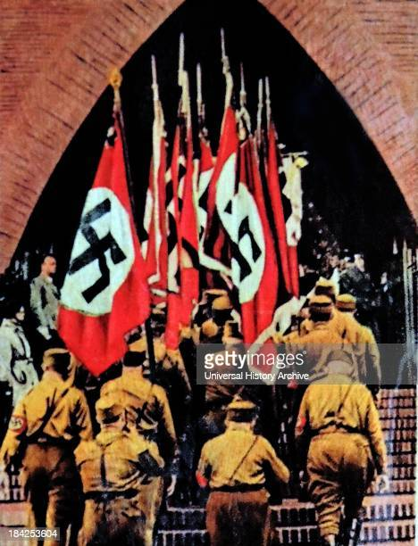 Nazi swastika flags are carried into a German Church circa 193336