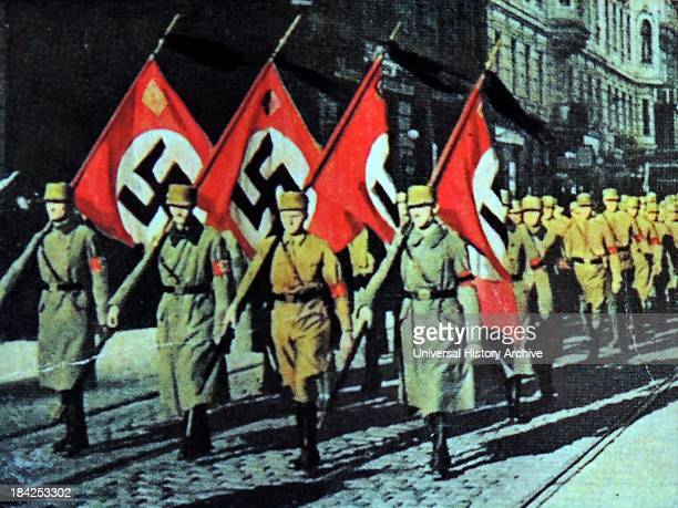 Nazi uniformed members with flags Germany circa 1931