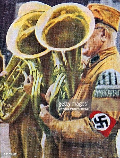 Nazi uniformed musician playing instrument at a rally Germany circa 1932