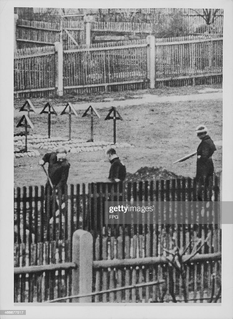 Nazi war criminals digging graves for forthcoming trials held in Landsberg Prison under military guard following World War Two Germany circa 19451946
