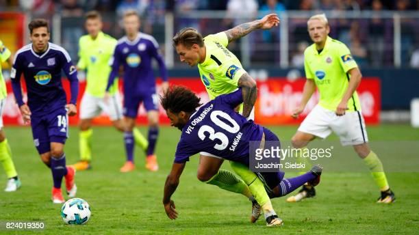 Nazim Sangare of Osnabrueck challenges Manuel Schaeffler of Wehen Wiesbaden during the 3 Liga match between VfL Osnabrueck and SV Wehen Wiesbaden at...