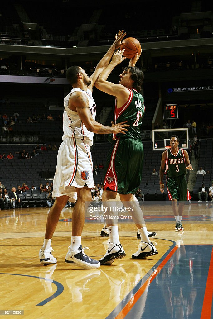 Nazr Mohammed of the Charlotte Bobcats guards against Andrew Bogut of the Milwaukee Bucks on October 20 2009 at Time Warner Cable Arena in Charlotte...