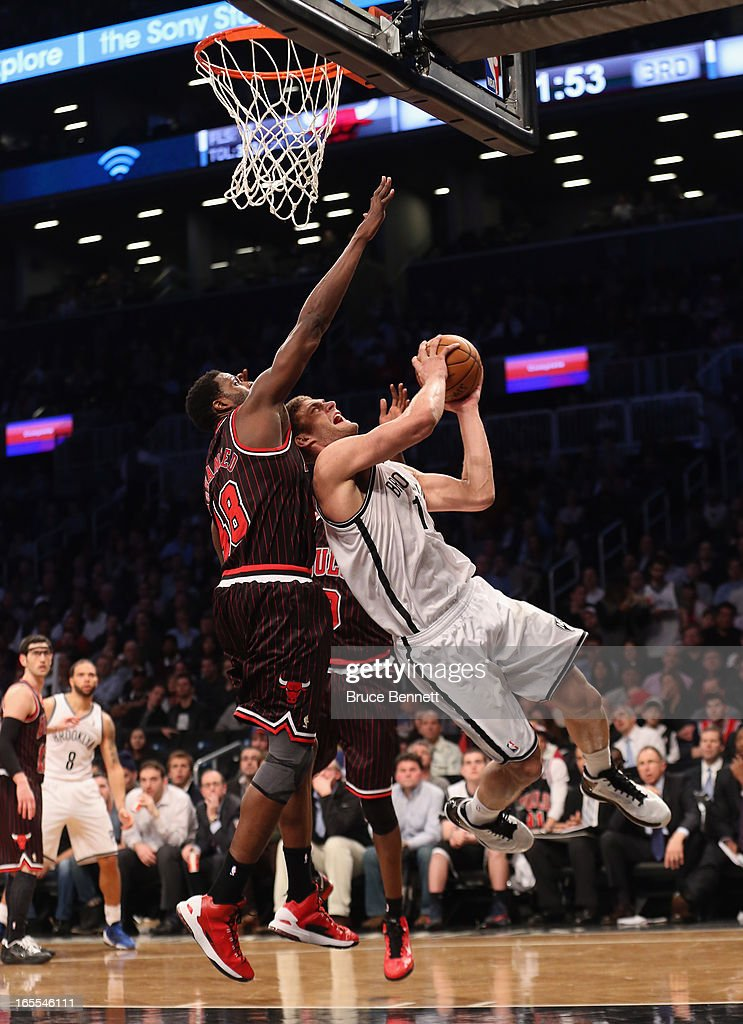 Nazr Mohammed #48 of the Chicago Bulls blocks Brook Lopez #11 of the Brooklyn Nets in the third quarter at the Barclays Center on April 4, 2013 in New York City.